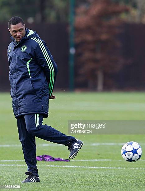 Chelsea's first team assistant coach Michael Emenalo watches the players during a team training session at the club's training ground in Cobham...