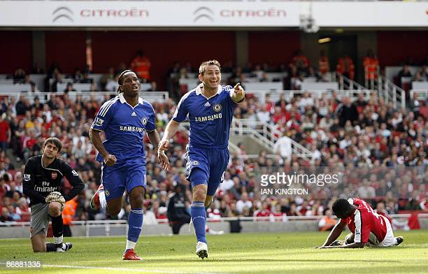 Chelsea's Frank Lampard and Chelsea's Ivory Coast footballer Didier Drogba celebrate the own goal by Arsenal's Ivory Coast player Kolo Toure with...