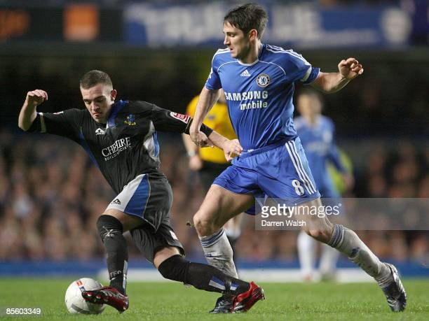 Chelsea's Frank Lampard and Macclesfield Town's Carl Regan battle for the ball