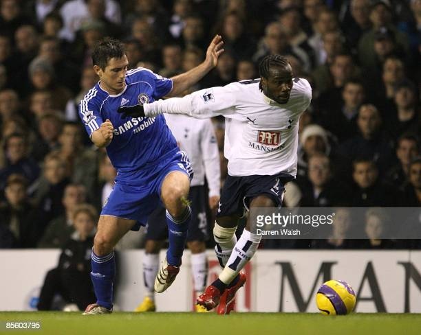 Chelsea's Frank Lampard and Tottenham Hotspur's Pascal Chimbonda battle for the ball