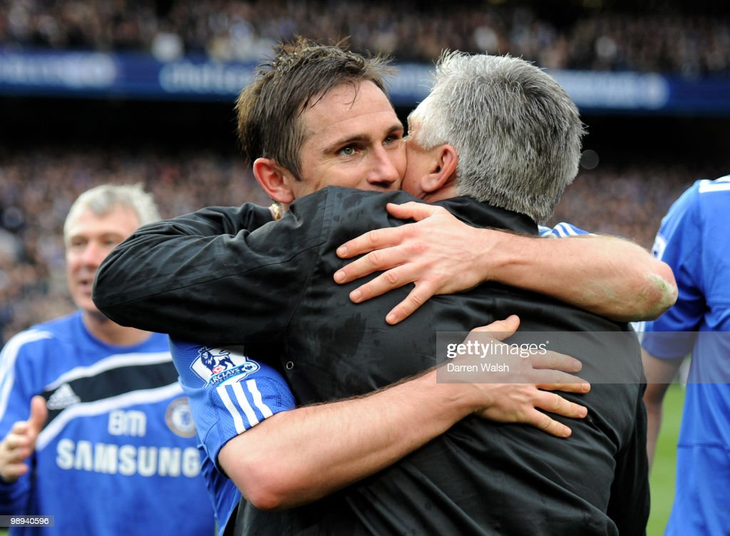 Chelsea's Frank Lampard hugs his manager, Carlo Ancelotti after winning the league with an 8-0 victory during the Barclays Premier League match between Chelsea and Wigan Athletic at Stamford Bridge on May 9, 2010 in London, England.