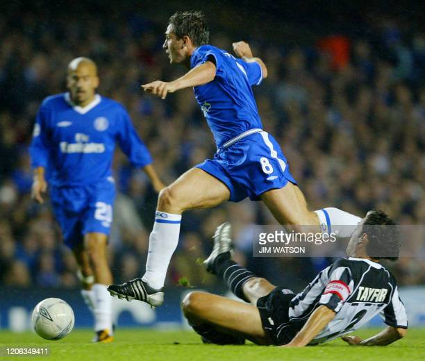Chelsea's Frank Lampard jumps clear of a tackle attempt by Besiktas' captian Havutcu Tayfur during their Champions League match at Stamford Bridge...