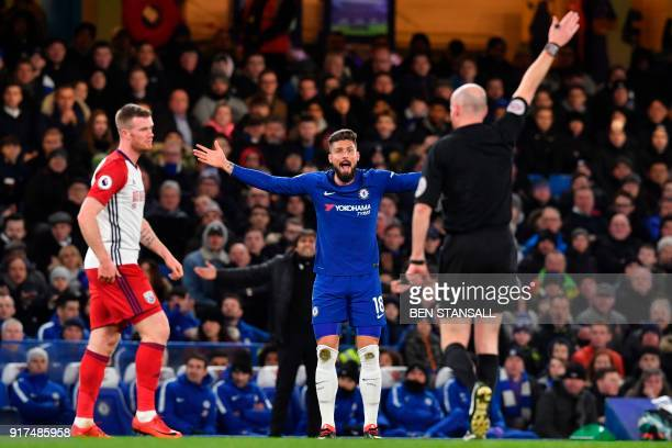 Chelsea's French attacker Olivier Giroud appeals to the referee Lee Mason during the English Premier League football match between Chelsea and West...