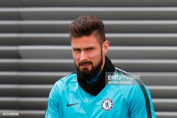 Chelsea's French attacker Olivier Giroud arrives to attend a team training session at Chelsea's Cobham training facility in Stoke D'Abernon southwest...