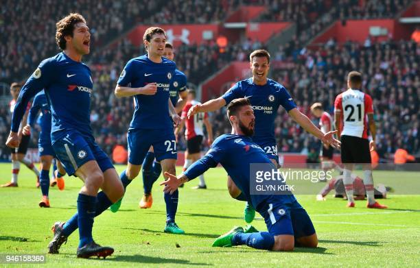 Chelsea's French attacker Olivier Giroud celebrates scoring their third goal with teammates Chelsea's Spanish defender Marcos Alonso Chelsea's Danish...
