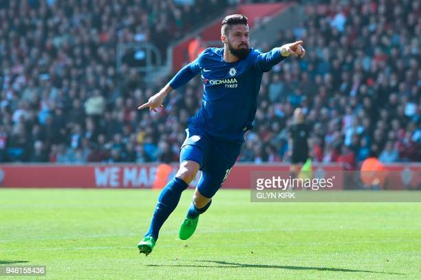 TOPSHOT Chelsea's French attacker Olivier Giroud celebrates scoring their third goal during the English Premier League football match between...