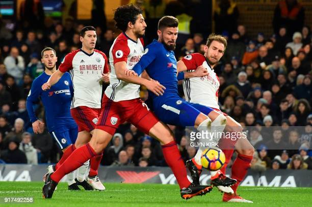 Chelsea's French attacker Olivier Giroud is challenged by West Bromwich Albion's English defender Craig Dawson and West Bromwich Albion's Egyptian...