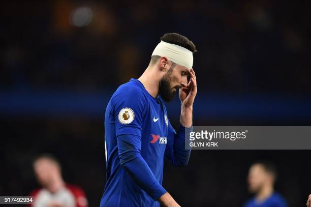TOPSHOT Chelsea's French attacker Olivier Giroud plays with a bandage on his head after getting caught in a challenge during the English Premier...