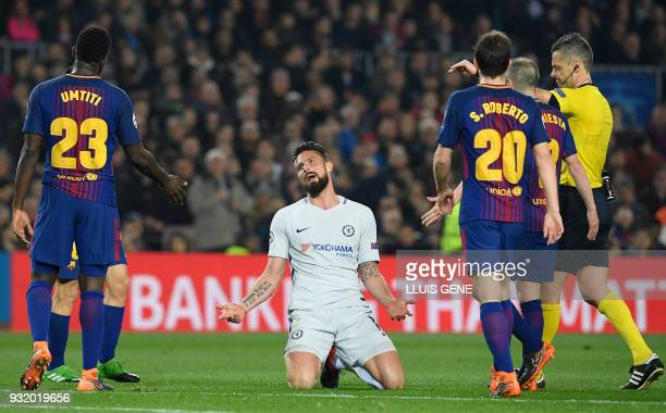 Chelsea's French attacker Olivier Giroud talks to Barcelona's French defender Samuel Umtiti during the UEFA Champions League round of sixteen second...