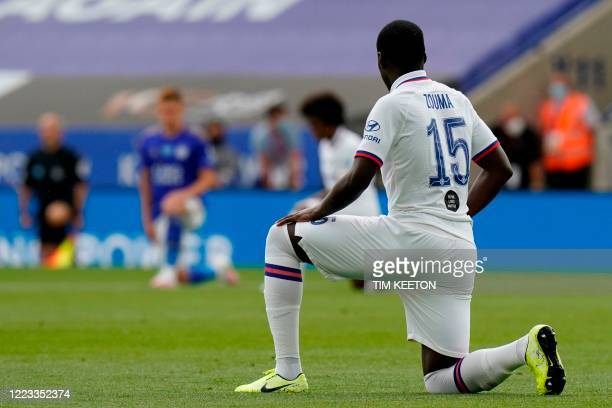 Chelsea's French defender Kurt Zouma and teammates 'take a knee' in support of the Black Lives Matter movement ahead of the English FA Cup...