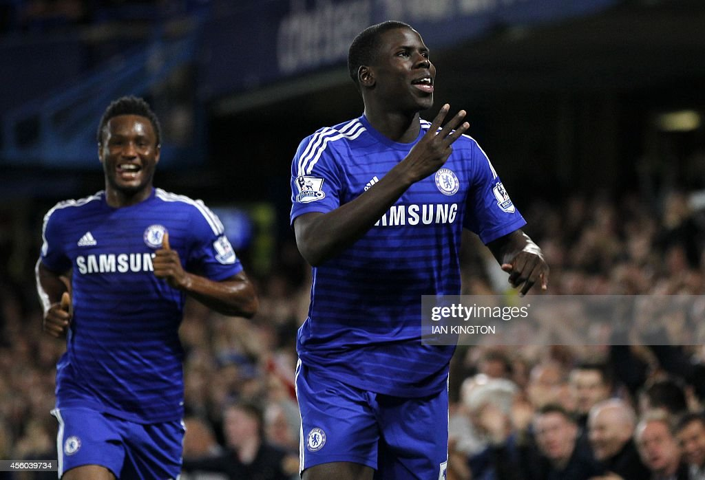 Chelsea's French defender Kurt Zouma (R) celebrates scoring the opening goal of the English League Cup third round football match between Chelsea and Bolton Wanderers at Stamford Bridge in London on September 24, 2014. USE. No use with unauthorized audio, video, data, fixture lists, club/league logos or 'live' services. Online in-match use limited to 45 images, no video emulation. No use in betting, games or single club/league/player publications.