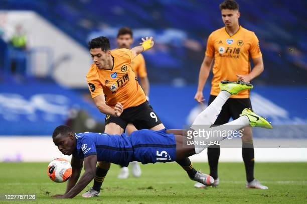 Chelsea's French defender Kurt Zouma dives in front of Wolverhampton Wanderers' Mexican striker Raul Jimenezduring the English Premier League...