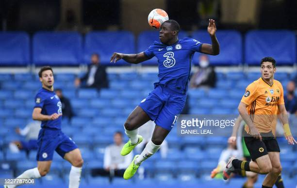 Chelsea's French defender Kurt Zouma jumps for the ball during the English Premier League football match between Chelsea and Wolverhampton Wanderers...