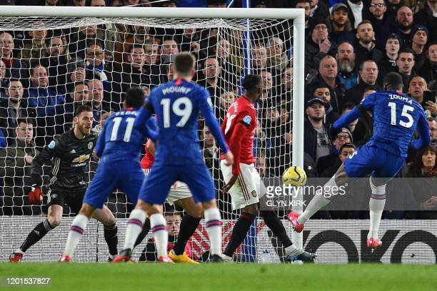Chelsea's French defender Kurt Zouma shoots to score but after a VAR review the goal is disallowed a foul in the buildup during the English Premier...