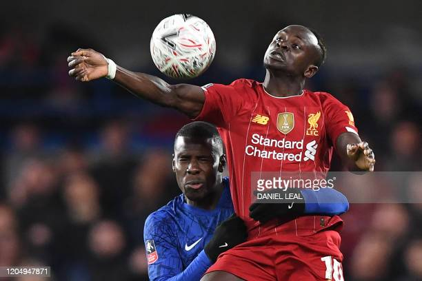 Chelsea's French defender Kurt Zouma tackles Liverpool's Senegalese striker Sadio Mane during the English FA Cup fifth round football match between...