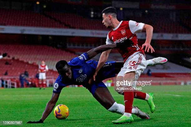 Chelsea's French defender Kurt Zouma vies with Arsenal's Brazilian striker Gabriel Martinelli during the English Premier League football match...