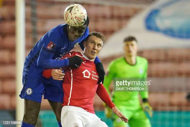Chelsea's French defender Kurt Zouma vies with Barnsley's English striker Cauley Woodrow during the English FA Cup fifth round football match between...
