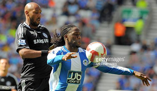Chelsea's French forward Nicolas Anelka vies with Wigan Athletic's Dutch defender Mario Melchiot during the English Premier league football match...