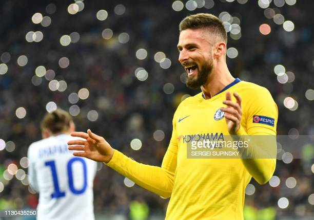 Chelsea's French forward Olivier Giroud celebrates after scoring his third goal during the UEFA Europa League round of 16 second leg football match...