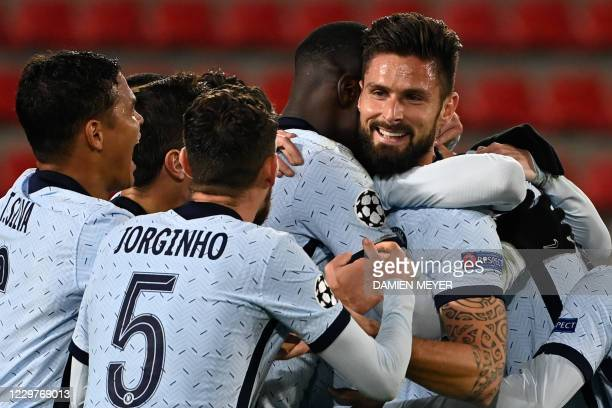 Chelsea's French forward Olivier Giroud celebrates after scoring his team's second goal during the UEFA Champions League Group E football match...