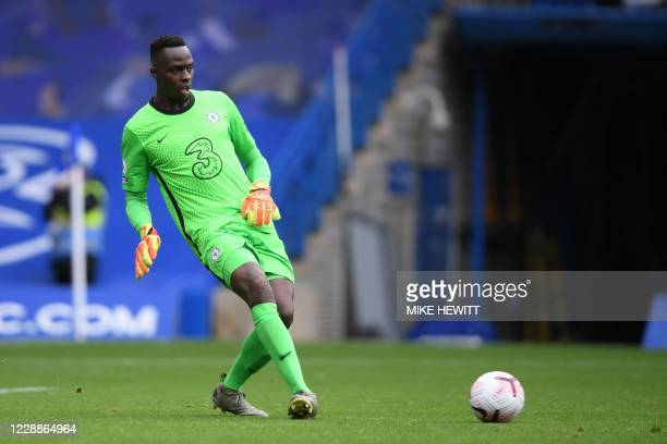 Chelsea's French goalkeeper Edouard Mendy kicks the ball during the English Premier League football match between Chelsea and Crystal Palace at...