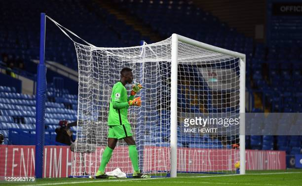 Chelsea's French goalkeeper Edouard Mendy takes a drink during the English Premier League football match between Chelsea and Leeds United at Stamford...