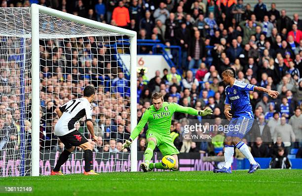 Chelsea's French midfielder Florent Malouda misses a chance on goal as Fulham's English goalkeeper David Stockdale and AustrianSwiss midfielder Kerim...