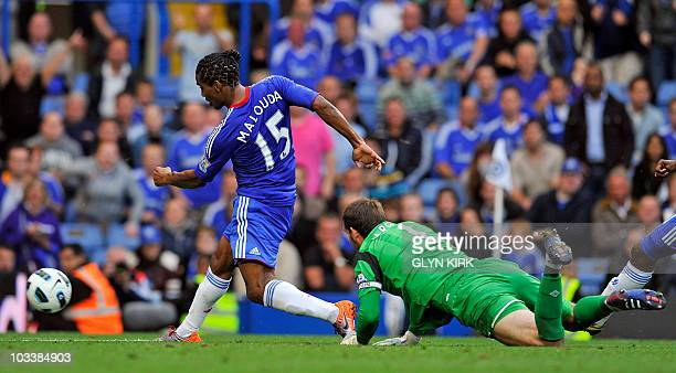 Chelsea's French midfielder Florent Malouda scores the sixth goal past West Brom's English goalkeeper Scott Carson during the English Premier League...
