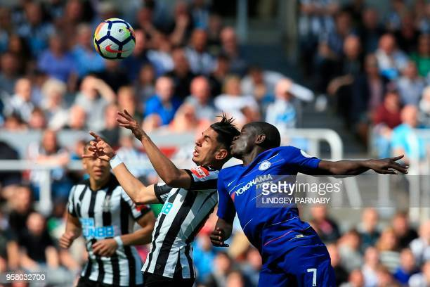 TOPSHOT Chelsea's French midfielder N'Golo Kante and Newcastle United's Spanish striker Ayoze Perez go for a ball during the English Premier League...