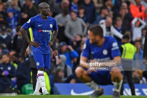 Chelsea's French midfielder N'Golo Kante and teammates react to their defeat on the final whistle in the English Premier League football match...