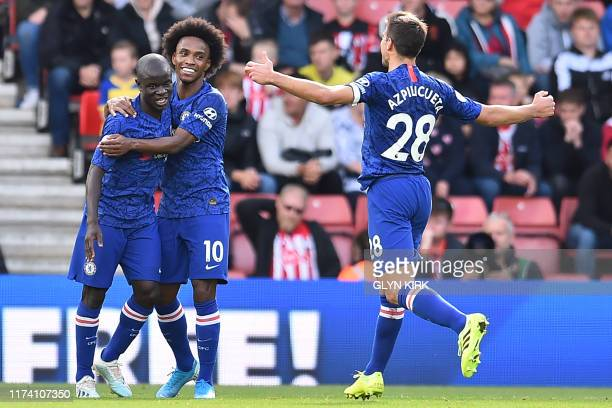 Chelsea's French midfielder N'Golo Kante celebrates with Chelsea's Brazilian midfielder Willian and Chelsea's Spanish defender Cesar Azpilicueta...