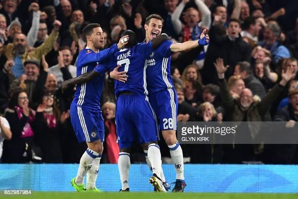 Chelsea's French midfielder N'Golo Kante celebrates with Chelsea's Belgian midfielder Eden Hazard and Chelsea's Spanish defender Cesar Azpilicueta...