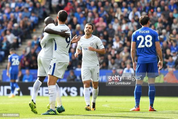 Chelsea's French midfielder N'Golo Kante cxelebrates with Chelsea's Spanish striker Alvaro Morata after scoring their second goal during the English...