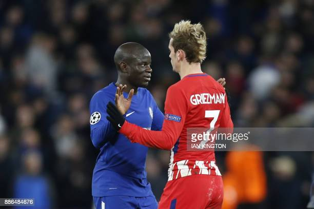 Chelsea's French midfielder N'Golo Kante greets Atletico Madrid's French striker Antoine Griezmann after the UEFA Champions League Group C football...