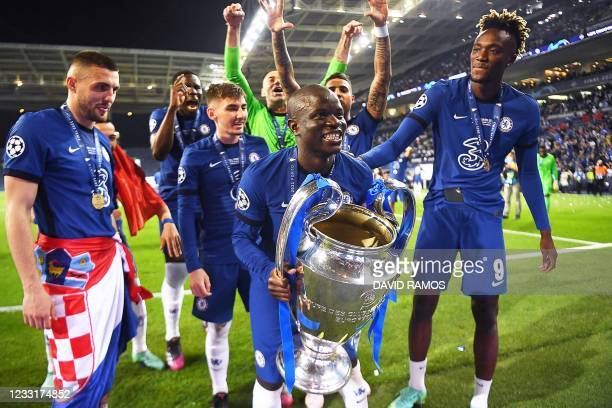 Chelsea's French midfielder N'Golo Kante lifts the trophy after winning the UEFA Champions League final football match between Manchester City and...