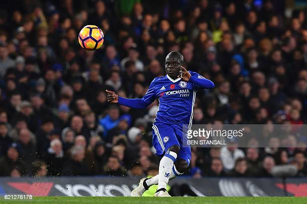 Chelsea's French midfielder N'Golo Kante passes the ball during the English Premier League football match between Chelsea and Everton at Stamford...