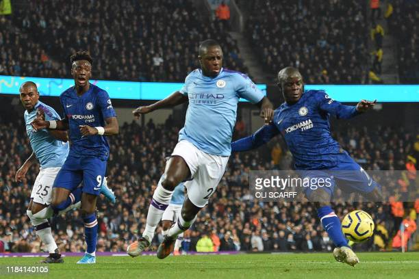 TOPSHOT Chelsea's French midfielder N'Golo Kante prepares to shoot past Manchester City's French defender Benjamin Mendy to score the opening goal of...