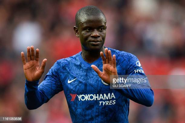 Chelsea's French midfielder N'Golo Kante reacts on the pitch at the final whistle in the English Premier League football match between Manchester...