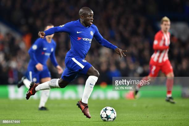 Chelsea's French midfielder N'Golo Kante runs with the ball during a UEFA Champions League Group C football match between Chelsea and Atletico Madrid...