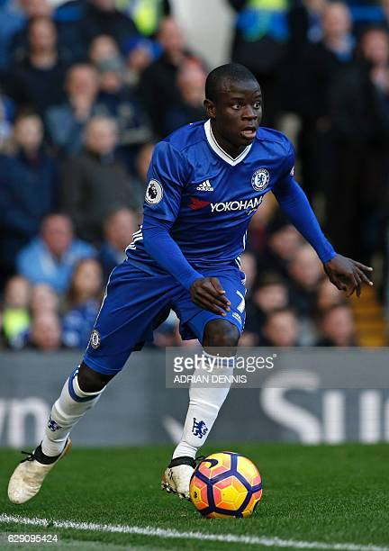 Chelsea's French midfielder N'Golo Kante runs with the ball during the English Premier League football match between Chelsea and West Bromwich Albion...