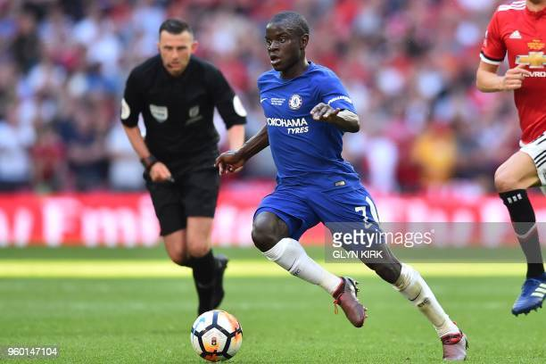 Chelsea's French midfielder N'Golo Kante runs with the ball during the English FA Cup final football match between Chelsea and Manchester United at...