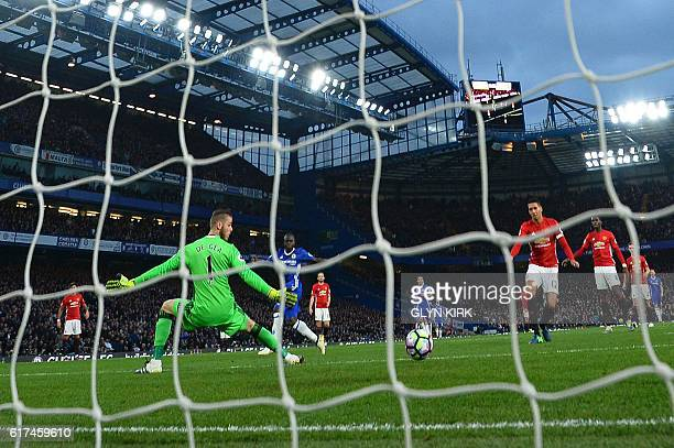 Chelsea's French midfielder N'Golo Kante scores their fourth goal during the English Premier League football match between Chelsea and Manchester...