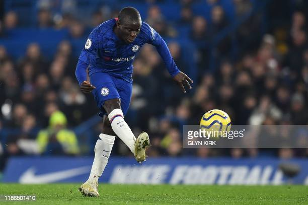Chelsea's French midfielder N'Golo Kante shoots but fails to score during the English Premier League football match between Chelsea and Aston Villa...