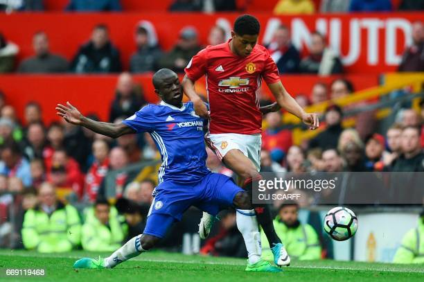 Chelsea's French midfielder N'Golo Kante tackles Manchester United's English striker Marcus Rashford during the English Premier League football match...
