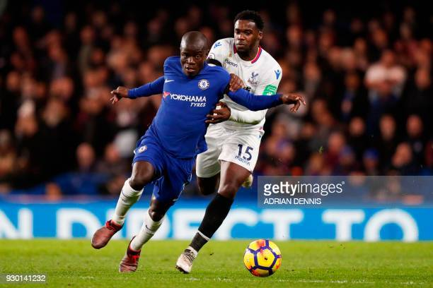 Chelsea's French midfielder N'Golo Kante takes on Crystal Palace's German midfielder Jeffrey Schlupp during the English Premier League football match...