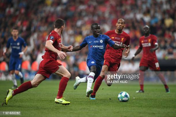 Chelsea's French midfielder N'Golo Kante vies for the ball with Liverpool's players during the UEFA Super Cup 2019 football match between FC...