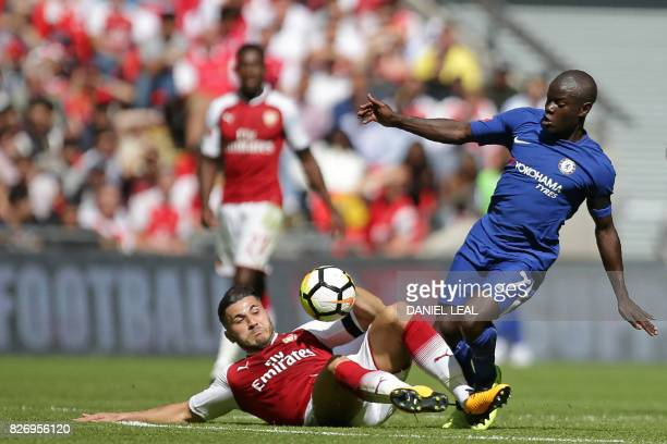 Chelsea's French midfielder N'Golo Kante vies with Arsenal's Germanborn Bosnian defender Sead Kolasinac during the English FA Community Shield...