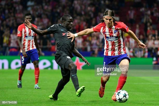 Chelsea's French midfielder N'Golo Kante vies with Atletico Madrid's Brazilian defender Filipe Luis during the UEFA Champions League Group C football...
