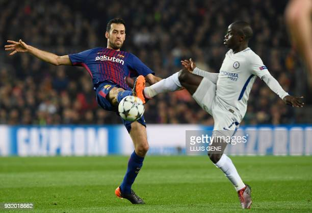 Chelsea's French midfielder N'Golo Kante vies with Barcelona's Spanish midfielder Sergio Busquets during the UEFA Champions League round of sixteen...