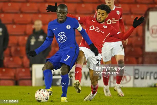 Chelsea's French midfielder N'Golo Kante vies with Barnsley's English midfielder Romal Palmer during the English FA Cup fifth round football match...